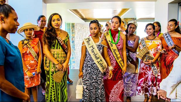 Miss American Samoa Epifania Petelo is center in red with many of the other contestants.