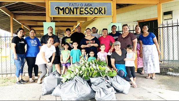 Faculty and parents of Fatuoaiga Montessori School pose for a photo after an hour of picking up trash