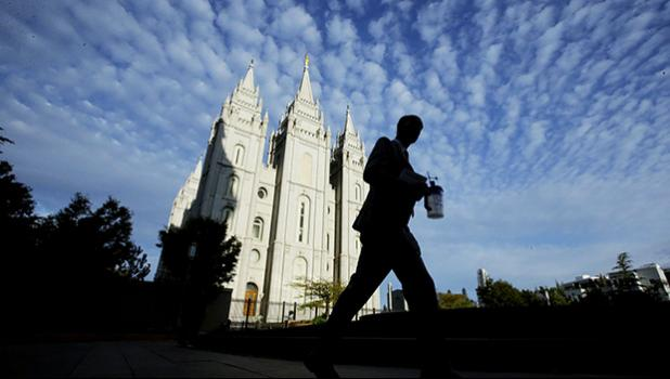 In this Sept. 14, 2016, file photo, a man walks past the Salt Lake Temple, a temple of The Church of Jesus Christ of Latter-day Saints, at Temple Square