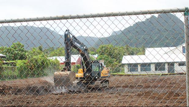 Backhoe working at the site