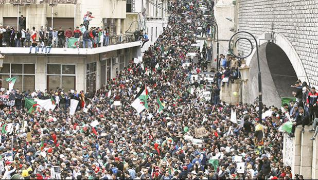 people gather for a demonstration in Algiers to protest President Abdelaziz Bouteflika's hold on power.