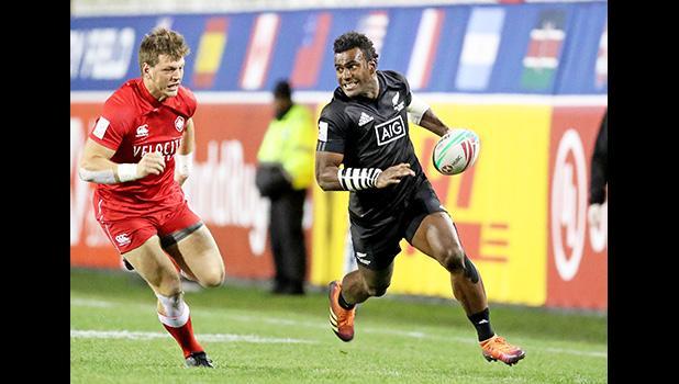 New Zealand's Akuila Rokolisoa scores against Canada
