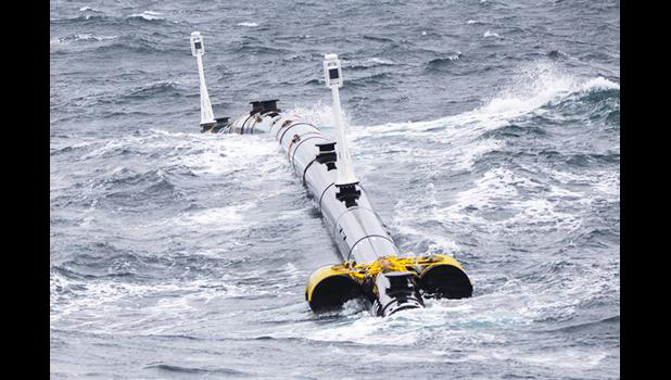 Photo of Ocean Cleaning Machine on the water.