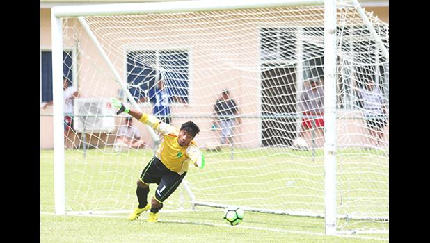 Goalkeeper for Lupe o le Soaga watches helplessly as the winning goal for Tupapa Maraerenga FC rolls past him during a penalty kick that came late in the second half of their match. Tupapa Maraerenga FC defeated Lupe o le Soaga 1 - 0. [photo: TG]