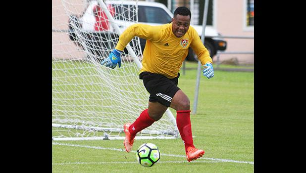 Tongan Goal keeper for Veitongo FC, Motekiai Faupula chasing down the ball inside the keepers box during the second half of their match up against Lupe ole Soaga last Friday. Veitongo lost 6 - 0. [photo: TG]