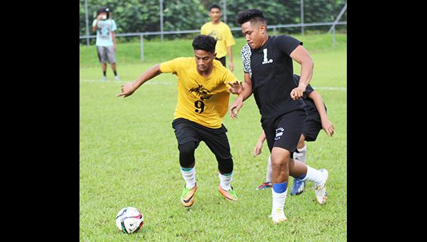 A Pago Youth player (left) and Tafuna Jets opponent