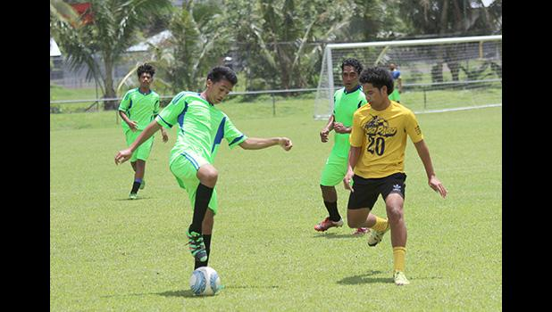 A Taputimu Youth player tries to control the ball