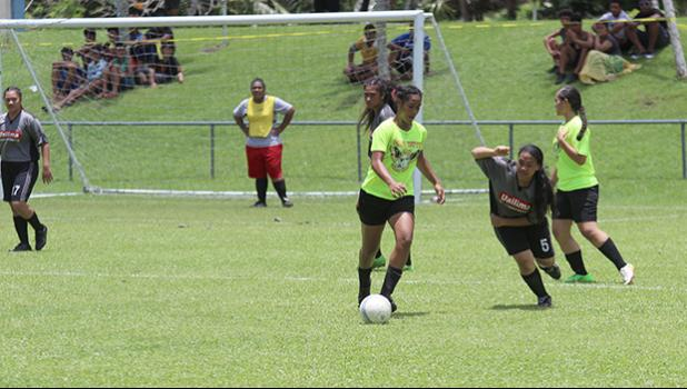 A Pago Youth player controls the ball against a Taputimu defender