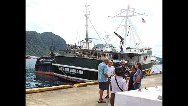 Facing the camera, Carlos Sanchez, a co-owner of several US- American Samoa based longliners is seen with the PBS TV crew.