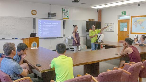 Translator Program Manager Autagavaia Tunai Alfred Peters explain proper pesticide disposal procedures