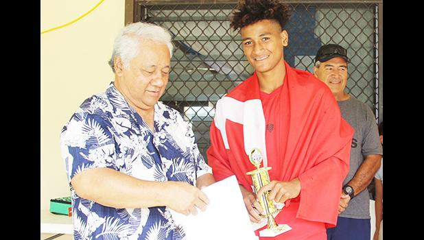 Petu Pouli of Vaiala Tongan's Boys 13-15 team receives his MVP award