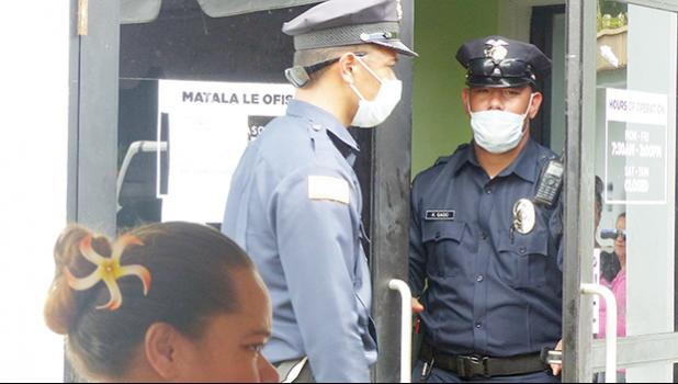 The two police officers exiting DHSS office