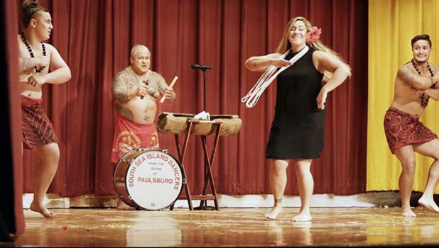"(L-R) Tino Savaiinaea, Chief Sikopu ""Scope"" Savaiinaea, Katie Savaiinaea-Elisaia and Niko Savaiinaea dance together"