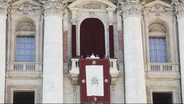 Pope Francis, background center, delivers the Urbi et Orbi (Latin for ′ to the city and to the world' ) Christmas' day blessing from the main balcony of St. Peter's Basilica at the Vatican, Monday, Dec. 25, 2017. (AP Photo/Alessandra Tarantino)