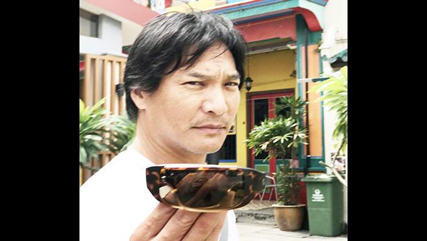 Movie actor, Jason Scott Lee displays the Popgear version of Popticals in Little India, Singapore. [photo: Barry Markowitz]