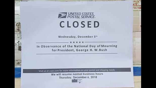 Sign at Post Office saying closed for National Day of Mourning