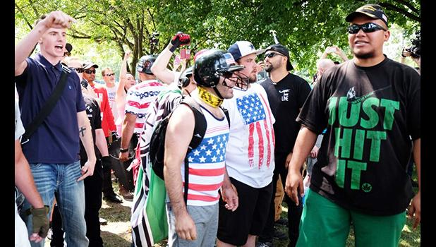 """Proud Boys during one of their rallies in Portland Oregon.  Tusitala """"Tiny"""" Toese is pictured right"""