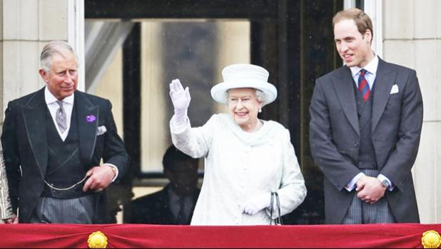 Queen Elizabeth II, center, accompanied by Prince Charles, left, and Prince William