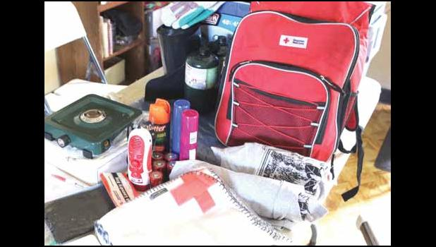 Pictured are some of the items being distributed by the American Red Cross to families whose homes were aff ected by Tropical Storm Gita last month. Th e care kits include necessities such as fl ashlights, batteries, fi rst aid kit, tarp, burner, and a cooler. [photo: THA]