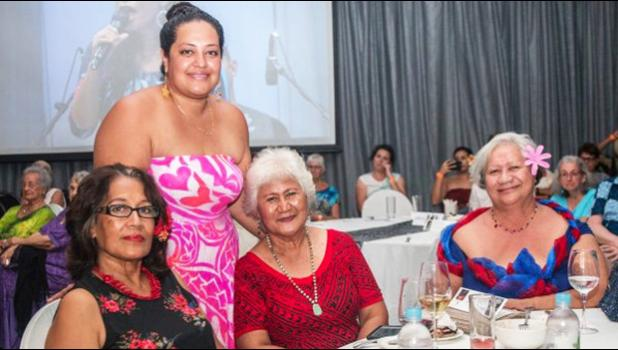 Renata Rivers in pink together with family and friends
