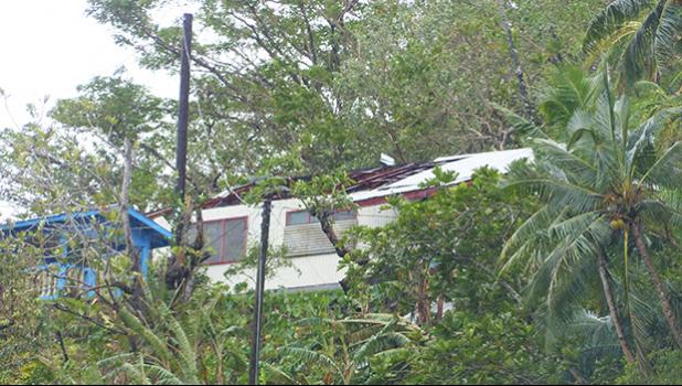 House with roof damage in Fagatogo