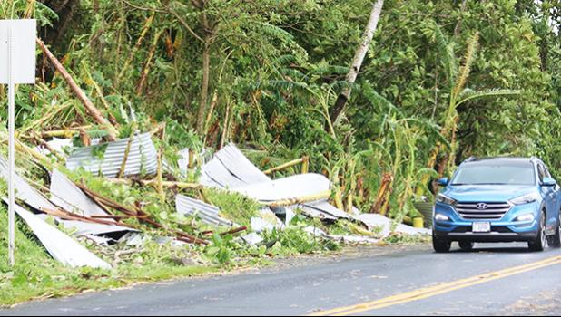 Mangled roofing iron from houses was a familiar sight on the side of the road after Tropical Storm Gita swept through the territory this past weekend. Up to 80+ mph gusts of winds took down not just trees and roofs of houses, but also telephone and electric poles adding to the devastation.  [photo: TG]