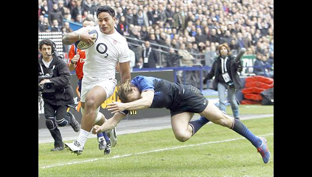 "This is a Sunday, March 11, 2012 file photo of England's Manu Tuilagi, left, as he runs to score a try despite the tackle of France's Aurelien Rougerie during their six nations rugby union match at the Stade de France stadium, in Saint Denis, outside Paris, Sunday. England's Rugby Football Union said Monday Aug. 7, 2017 that Manu Tuilagi and Denny Solomona have been sent home from a national team training camp. An RFU statement says the disciplinary action is a result of ""culture issues"" with no further exp"