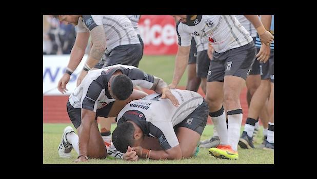 An emotional and fatigued Fiji Bati team celebrates their 20-18 victory over Toa Samoa at Apia Park, Samoa, 10/8/16. [Photo: Barry Markowitz]