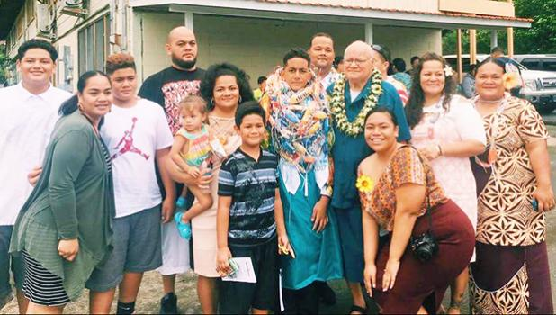 Former Associate Judge Siaki Logoai with his family, following the 8th grade graduation ceremony at the Home of the Flames last Thursday where his grandson Sam was one of 35 who received their diplomas. [photo: BC]