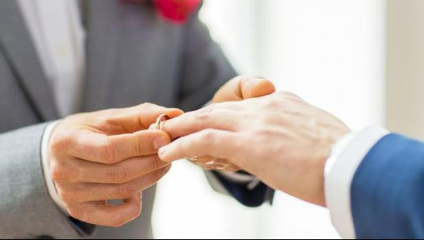 Photo of men's hands with wedding rings