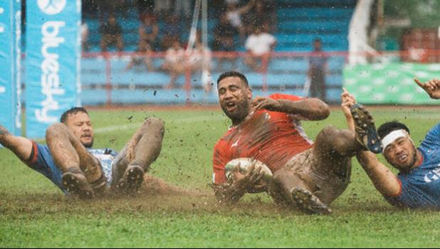 Cooper Vuna scores a try against Samoa on muddy field.