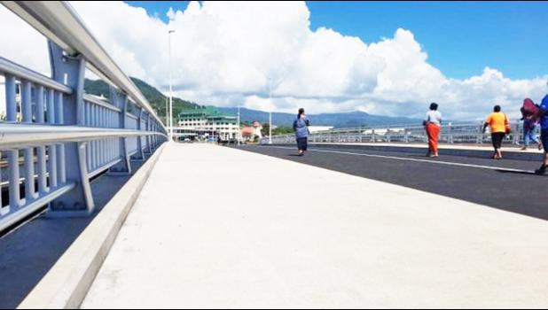 People out exercising on the new Vaisigano bridge