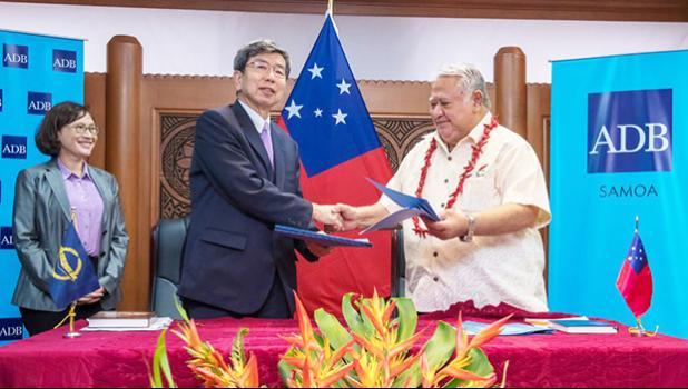 ADB President Mr. Takehiko Nakao (middle) with Samoa Prime Minister Tuilaepa Lupesoliai Sailele Malielegaoi (right) and ADB Director General for the Pacific Ms. Carmela Locsin (left)
