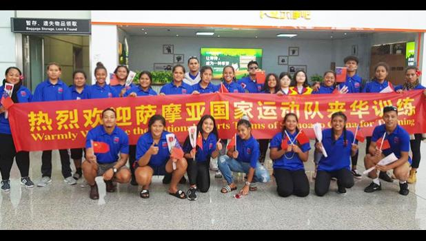 Samoa athletes in a photo with Chinese coaches