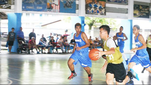 Marist Crusaders with a fast break, while Samoana Sharks try to chase them down, last Saturday morning at the Samoana High School Gymnasium in Utulei.  [photo: Ese Malala]