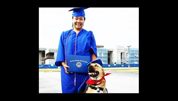 Miss Jee Hae Choe of Faleniu with her service dog DannyBoy since 2013. DannyBoy helped her come out of severe depression and inspired her to open a business helping and training dogs. She is seen here after graduating from Eastern Florida State College, with DannyBoy. Her business will open this weekend, in Florida — for more information visit www.samoandogtrainer.com.  [Courtesy photo]