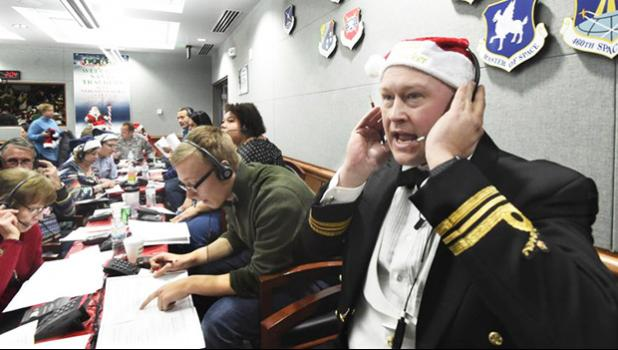 Canadian Lt. Maj. Chris Hache takes a call while volunteering at the NORAD Tracks Santa center