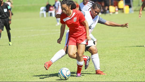 Saono Enesi of American Samoa dribbles the ball