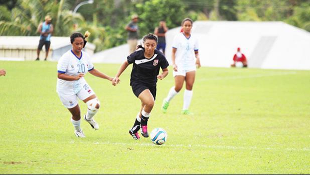 Saono Enesi of American Samoa, right, dribbles away