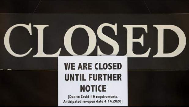 a notice of closure is posted at The Great Frame Up in Grosse Pointe Woods, Mich.