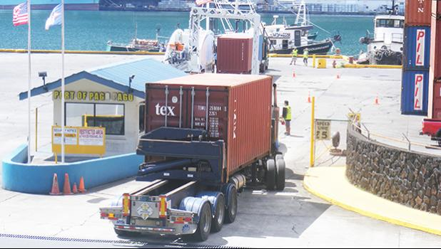 At 2:30p.m last Friday a container truck [top of photo] went through the container scanner equipment, while another container truck [bottom of photo] waited at the entrance to the Port of Pago Pago for its turn to go through the scanner located at the main dock.  [photo: FS]