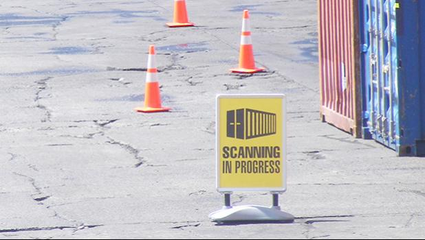 "This Customs Division ""SCANNING IN PROGRESS"" sign was seen placed by a Customs agent just off the entrance to the Port of Pago Pago, before two container hauling trucks entered the main dock and went through the container scanner equipment around 2:30 p.m last Friday.  [photo: FS]"