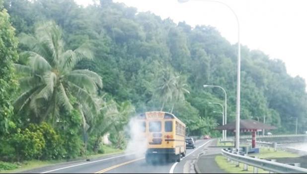School bus spewing white smoke