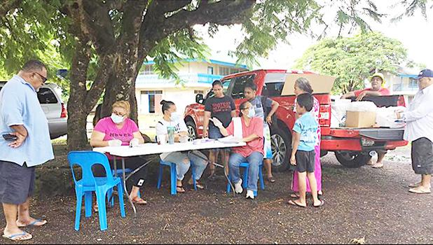 A Crew from the School Lunch Program, sitting at the table yesterday morning at Manulele Tausala Elementary School compound