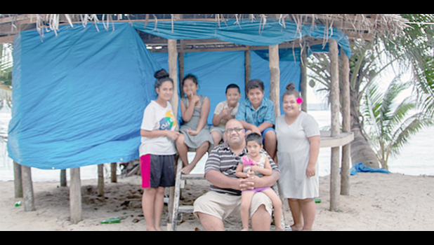 Perelini Ulugia with his children, neices and nephews in his growing beach fale business, Jaymy's