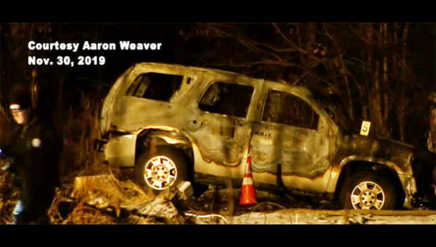 The burned out car where the bodies were found.