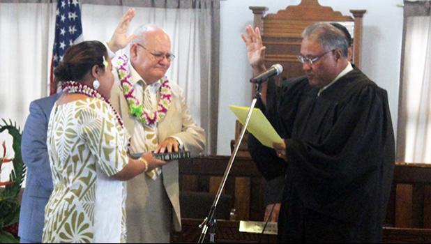 Chief Associate Judge Mamea Sala Jr., administers the oath of office to Logoai Siaki Logoai
