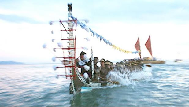 A traditional war canoe, Tomoko, from Roviana in the Western Solomons participates in the Pacific flotilla at the opening of the 11th Festival of Pacific Arts in Honiara. June 2012.  American Samoa hosted in 2008 and Hawaiʻi will be hosting in 2020.