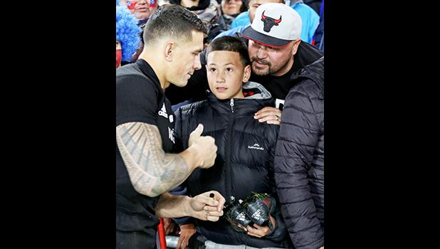 Sonny Bill Williams amazed Mason Smales with a gift of his red striped Adidas game shoes.   Mason is a cousin of the late beloved Peter Fatialofa.  The New Zealand All Blacks defeated Manu Samoa 15s 78-0 at Eden Park, Auckland, New Zealand.   [Photo: Barry Markowitz]