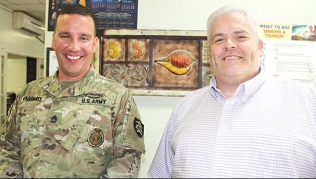 Neil Woolf (right) with Sgt. First Class Nick Marshall